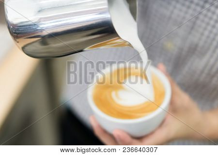 Woman Barista Pouring Stream Milk For Making Latte Art Coffee With Heart Shape In White Cup, Selecti