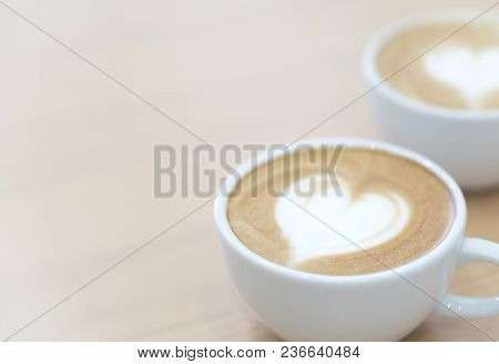 Closeup Latte Art Coffee With Heart Shape In White Cup For Relax Time And Holiday Concept, Selective