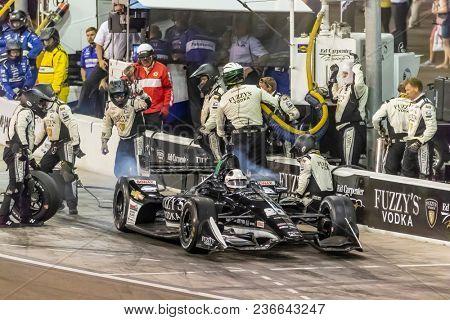 April 07, 2018 - Avondale, Arizona, USA: Ed Carpenter (20) brings his car down pit road for service during the Desert Diamond West Valley Casino Phoenix Grand Prix at ISM Raceway in Avondale, Arizona.