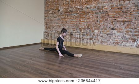 Sport Fitness. Yoga Gymnastics. Exercise Training. Young Fit Teenage Girl Warming Up Stretching In A