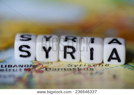 Word Syria Formed By Alphabet Blocks On Atlas Map Geography