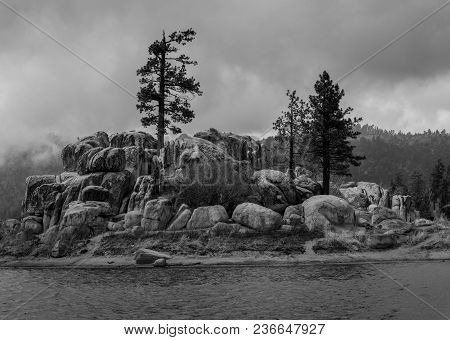 A Mountain Storm Rolls In Over A Boulder Island In The California Mountains. Black And White Edit