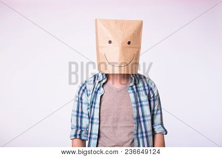 Unknown Man With A Paper Bag On His Head On White Background.