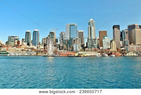 Seattle, Washington Waterfront And City Skyline Views With The Iconic Great Wheel And Pier 56