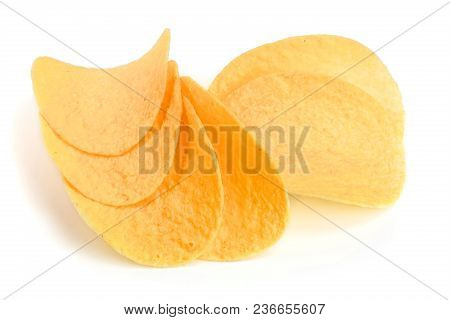 Heap Of Potato Chips On White Background Close-up.