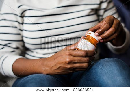 Woman taking pills for her health