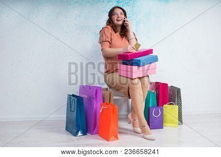 Happy Woman After Shopping With Bags, Boxes, Banking Card, Phone