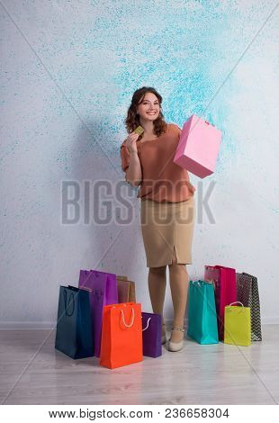 Happy Woman Stands With Shopping Colorful Bags, Boxes, Banking Card