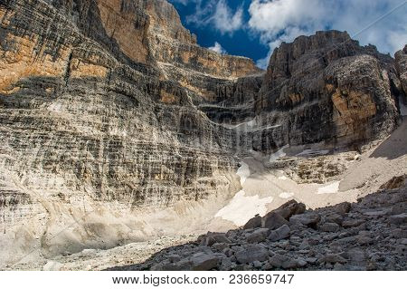 Beginning Of Mountain Valley Shapped Like A Cauldron. Brenta Dolomites, Italy.