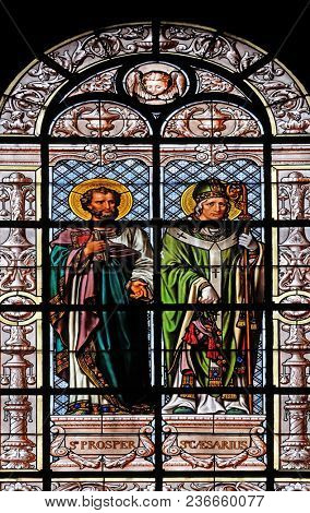 PARIS, FRANCE - JANUARY 10: Saint Prosper and Saint Caesarius, stained glass window in the Saint Augustine church in Paris, France on January 10, 2018.