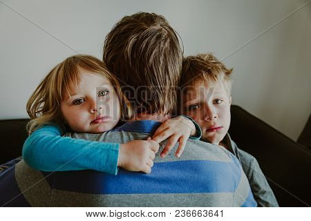 Sad Kids Hugging Father, Family In Sorrow, Loss And Pain Concept