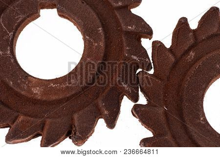 Two Incredible Rusty Chocolate Gears. Isolated On White