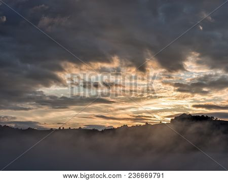 Beautiful Sunrise Light Over The Peaks Of The Mountains With Trees Silhouettes, Fundatura Ponorului,
