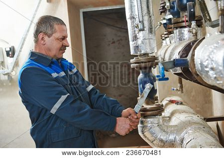Plumbing heating engineer repairman in boiler room