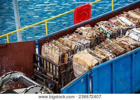 Bundled Cardboard Ready For Recycling In Container