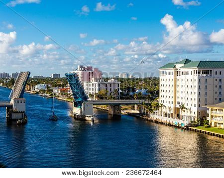 A Sailboat Motoring Through An Open  Drawbridge In Fort Lauderdale