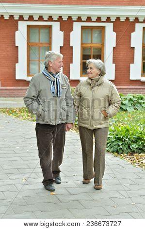 Portrait Of Beautiful Caucasian Senior Couple Walking  In City