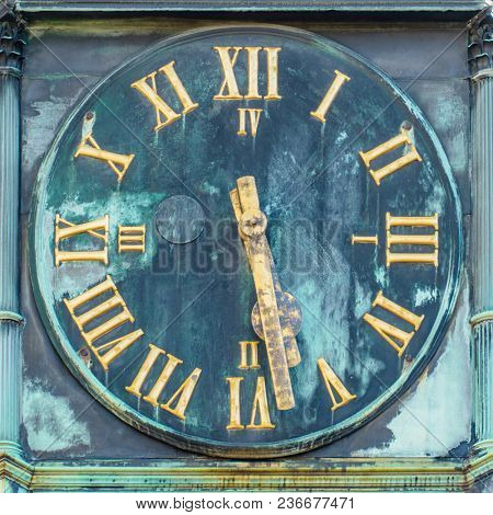 An image of a clock with golden hands Esslingen Germany