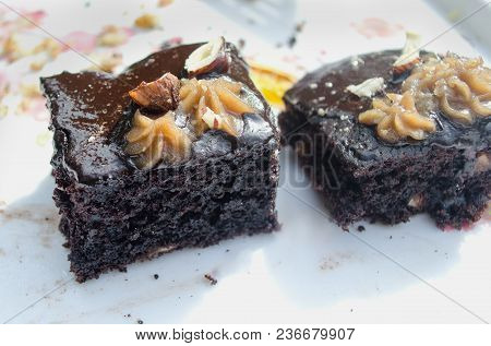 Piece Of Chocolate Cake On A White Plate