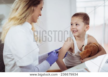 Doctor Doing Vaccine Injection To A Child, Medicine, Healthcare, Pediatry And People Concept