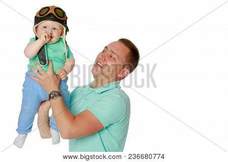 Dad Holds The Baby In His Arms. The Concept Of Educating The Father Of Young Children, Happy Childho