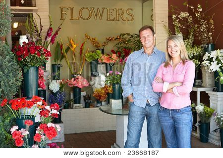 Man and women standing outside florists