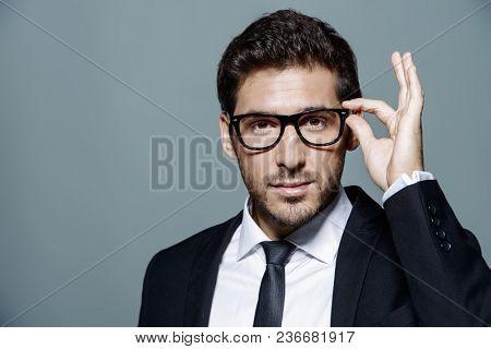 Portrait of a contemporary businessman in a suit. Studio shot.