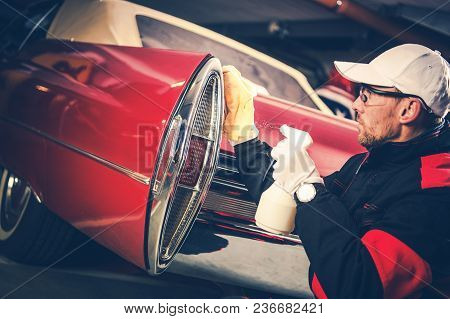 Classic Cars Detailing Cleaning Performing By Professional Body Cleaning Worker.