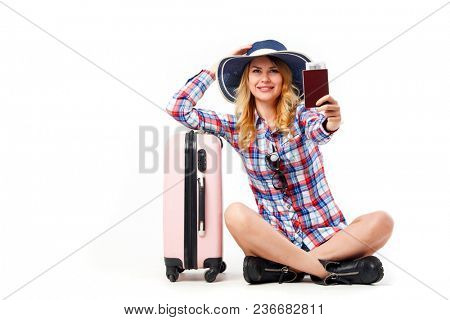 Photo of seated woman in hat with suitcase isolated on white background