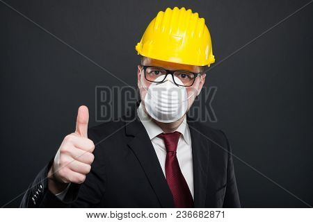 Business Man Wearing Hardhat And Mask Showing Like.