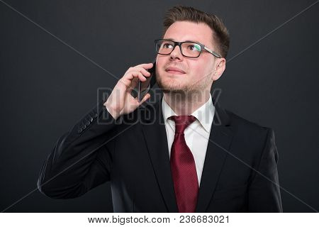 Business Young Man Talking At Black Smartphone.