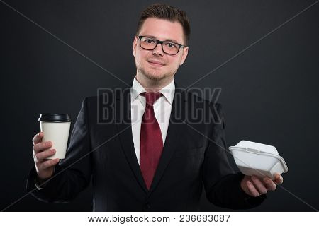 Portrait Of Business Man Holding Coffee And Lunchbox.