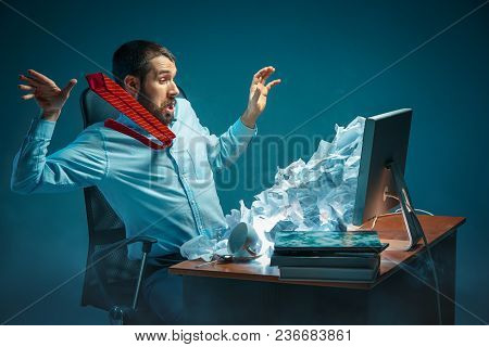 Young Stressed Handsome Businessman Working At Desk In Modern Office Shouting At Laptop Screen And B
