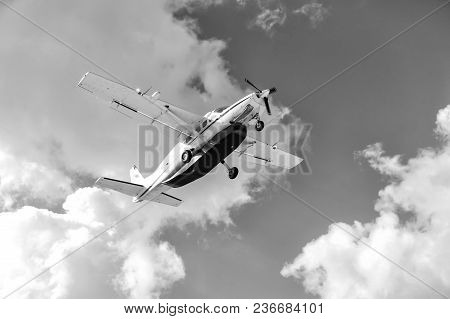 Aircraft Fly On Air In Philipsburg, St Maarten On Sunny Day On Cloudy Blue Sky. Vacation, Travelling
