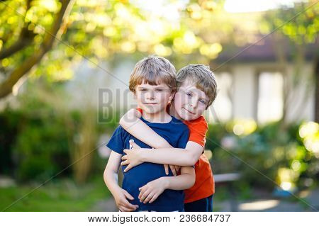 Two Little Active School Kids Boys, Twins And Siblings Hugging On Summer Day. Cute Brothers, Prescho