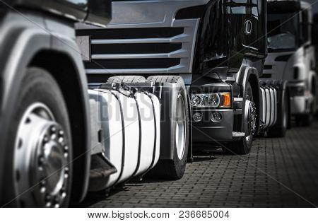 Euro Semi Trucks Staying In Traffic To The Storage Gate. Heavy Duty Transportation Theme.