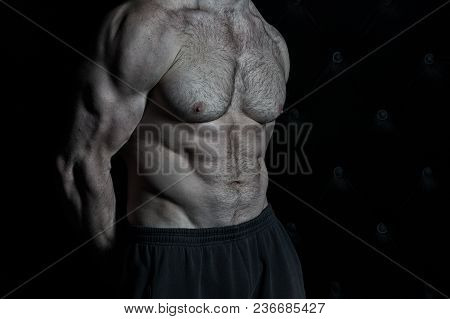 Muscular Torso Of Strong Athletic Fitness Model. Torso Showing Six Pack Abs, Vintage.