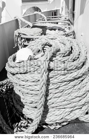 Nautical Ropes On Ship Deck Background In Philipsburg, Sint Maarten On Sunny Day . Rolls Of Green St
