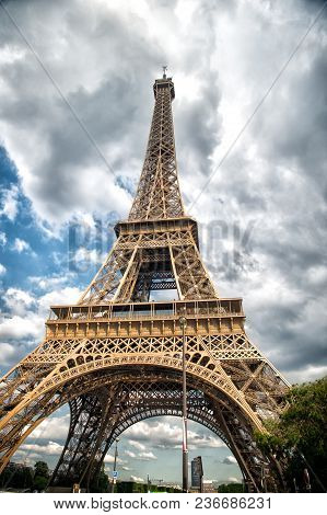 Eiffel Tower In Paris, France. Tower On Cloudy Sky. Architecture Structure And Design Concept. Summe