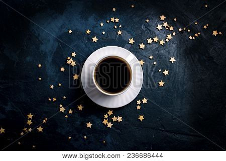 Cup Of Coffee And Stars On A Dark Blue Background. Concept Of The Starry Sky And Coffee. Flat Lay, T
