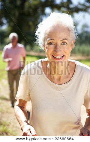 Senior couple on country run