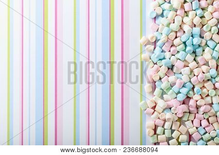 Marshmallows On A Striped Background . Background Or Texture Of Colorful Mini Marshmallows.top View,