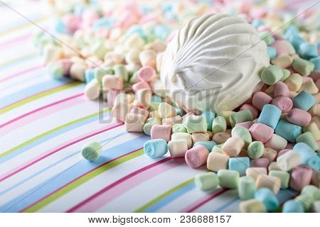 Close Up Of Various Marshmallows On A Striped Background , Copy Space.