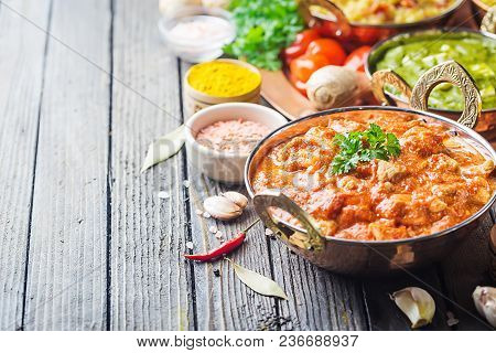 Different Bowls With Assorted Indian Food On Dark Wooden Background. Dishes And Appetizers Of Indian