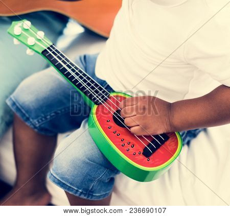 Closeup of hand with ukulele music instrument
