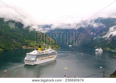 Geiranger, Norway - January 25, 2010: Travel Destination, Tourism. Cruise Ship In Norwegian Fjord. P