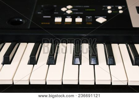 A Photo Of Old Used Synthesizer, Electronic Musical Keyboard. Keyboard Or Piano For Digital Music Re