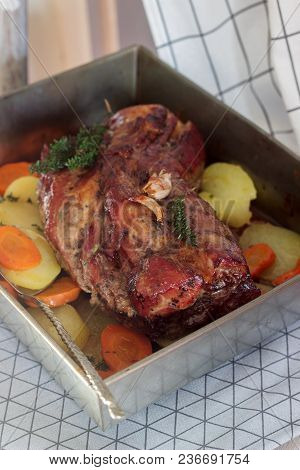 Appetizing Boiled Pork With Potatoes And Carrots, Baked In A Tin Pan. Rustic Style, Selective Focus.