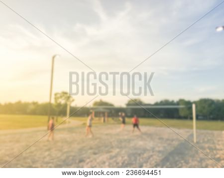 Blurred Healthy People Play 2-on-2 Sand Volleyball