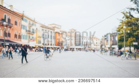 People Walking In The City Square, Blurred Backgound. Verona, Italy